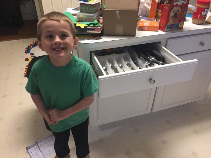 Andrew's son standing in front of the newly installer kitchen drawer