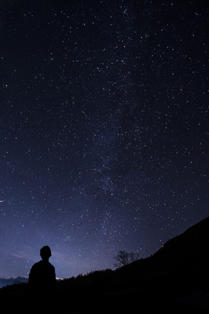 Man looking at a starry sky